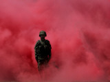 Amidst Smoke from a Flare, a Soldier Attends a Military Ceremony in Cali, Colombia Photographic Print