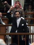 Former Iraqi President Saddam Hussein Berates the Court During their Trial in Baghdad Fotografie-Druck