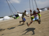 Children Play in a Park Near a New Camp Being Set Up for Earthquake Survivors in Port-Au-Prince Photographic Print