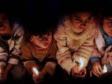 Palestinian Children Hold Candles in a Memorial Ceremony for the Anniversary of Israel's Offensive  Photographic Print