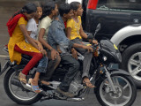 Boy Rides a Motorbike with Four Girls, as it Drizzles in Hyderabad, India Photographic Print