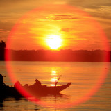 Reflection of Sunshine Above a Fishing Boat on the Tonle Sap River in Cambodia Photographic Print