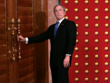 President George W. Bush as He Tries to Open a Locked Door Leaving a Press Conference in Beijing Photographic Print