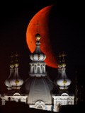 Moon is Seen Rising in the Sky Above the Domes of the Smolny Cathedral in St.Petersburg, Russia Photographic Print