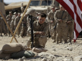 US Marine Pays His Respects to LCpl Joshua Bernard During a Memorial Service at Base in Afghanistan Photographic Print