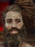 Hindu Holy Man Looks on from the Banks of River Ganges During the Kumbh Mela Festival in Haridwar Reproduction photographique