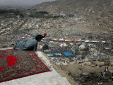 Afghan Youth Sits on a Rooftop During the Celebration of Nowruz Photographic Print