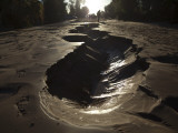 Walking on Mud Caused by Underground Water That Leaked to the Surface During an Earthquake, Mexico Photographic Print