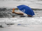 Member of Winter and Ice Swimming Club, Swims with an Umbrella in Frozen Oranke Lake in Berlin Photographic Print
