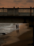 Couple Stand at Galle Face Beach, in Colombo, Sri Lanka Photographic Print