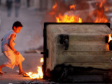Bahraini Child Plays Near to Burning Tires and a Dumpster Photographic Print