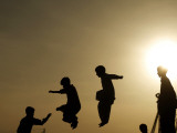 Youths Play on a Trampoline at Sunset in the Neighborhood of Islamabad, Pakistan Photographic Print