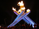 Spectators Surround the Olympic Flame at the Vancouver 2010 Olympics Photographic Print