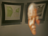 Lithograph by Nelson Mandela is Seen Reflected on a Photographic Portrait of Mandela Photographic Print