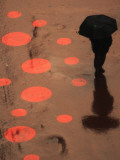 Pedestrian Makes His Way in New York&#39;s Times Square in the Rain Photographic Print
