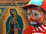"Young Clown, ""Bolillito,"" Stands Next to an Image of the Virgin of Guadalupe in Mexico City Photographic Print"