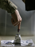 Iraqi Security Forces Member Inks His Finger after Casting His Vote at a Polling Center in Iraq Photographic Print