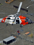 Coast Guard Rescues One from Roof Top of Home, Floodwaters from Hurricane Katrina Cover the Streets Photographic Print