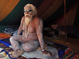 Naked Hindu Holy Man Sits Inside on the Banks of the River Ganges During the Kumbh Mela in India Photographic Print