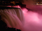 Red Lights Illuminate the American Falls in Niagara Falls, New York Photographic Print