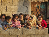 Palestinian Girls Giggle While Photographed Where Shell from an Israeli Gunboat Landed Earlier Photographic Print