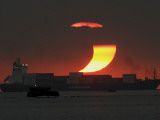 Partial Solar Eclipse as the Sun Sets at Manila's Bay, Philippines Photographic Print