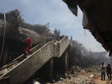 Indonesian Rescue Workers Walk on a Eartquake Damaged Building, in Padang, Indonesia Photographic Print