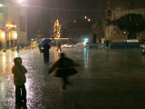 Children Play in the Rain in Front of the Church of the Nativity in Bethlehem on Christmas Eve Photographic Print