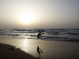 Palestinian Man Performs a Summersault on the Beach of the Mediterranean Sea in Gaza City Photographic Print