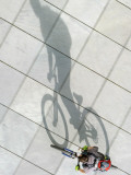 Sun Casts the Shadow of a Cyclist in Berlin, Germany Photographic Print