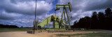 Oil Drill in a Field, Grand Traverse County, Michigan, USA Photographic Print by  Panoramic Images