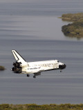 Space Shuttle Discovery Glides over the Banana River to a Landing on Kennedy Space Center's Runway Photographic Print