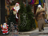 Palestinian Woman Walks Past Christmas Decorations at a Shop in Jerusalem's Old City Photographic Print