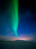 Aurora Borealis over a Snowy Landscape, Iceland Photographic Print