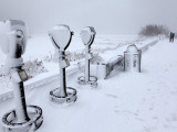 Telescope Viewers are Covered in Snow Overlooking Lighthouse Beach in Chatham, Massachusetts Photographic Print