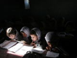 Afghan School Girls Read their Lessons at the Aziz Afghan Secondary School in Kabul, Afghanistan Photographic Print