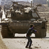 Palestinian Stone Thrower Faces an Israeli Tank, Between Israel and the Gaza Strip Photographic Print