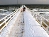 Tourists Walk on the Snow Covered Sea Bridge Pier in a North German Baltic Sea Resort Photographic Print