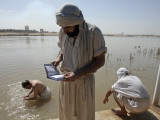Members of Sabean Mandaeans Practice their Rituals on Banks of Tigris River in Baghdad, Iraq Photographic Print