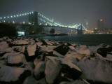 Snow Covered Rocks on the Brooklyn Shore of the East River Photographic Print