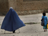 Afghan Girl Carries the Ration of Her Mother, a Victim of Land Mines, in Kabul, Afghanistan Photographic Print