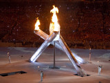 Standing with the Burning Olympic Cauldron at the Opening Ceremonies for the 2010 Winter Games Photographic Print