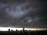 Thick Dark Cloud Hangs over Jakarta, Indonesia, before a Thunder Storm Photographic Print