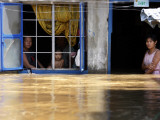 Family Look Out from House Where are Suffering from Flooding in Pungo Village, Northern Philippines Photographic Print