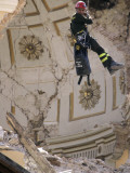 Firefighter as He Looks Inside the Damaged Dome of the Church of Santa Maria Del Suffragio Photographic Print