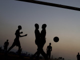 People Play Soccer at a Camp Set Up for Earthquake Survivors Left Homeless in Port-Au-Prince Photographic Print