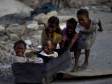 Children Play with a Suitcase Near a Camp for People Displaced by the Earthquake in Port-Au-Prince Photographic Print