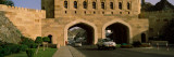 Road Passing Through Archways, Muscat Gate Museum, Al Saidiya Street, Muscat, Oman Photographic Print by  Panoramic Images