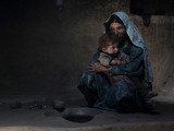 Sarab Village Resident Comforts Her Son after Having Early Morning Opium Smoke with Family Members Photographic Print