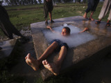 Youth Swims in a Water Reservoir as the Temperature Rises, on the Outskirts of Islamabad, Pakistan Photographic Print